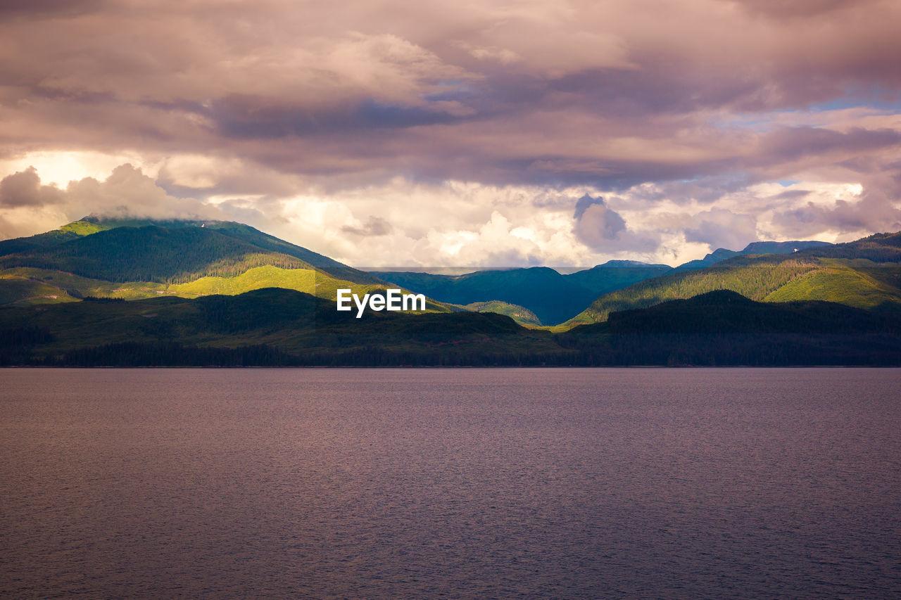 cloud - sky, beauty in nature, mountain, sky, scenics - nature, water, tranquility, tranquil scene, mountain range, waterfront, nature, no people, idyllic, lake, non-urban scene, outdoors, sunset, day, mountain peak