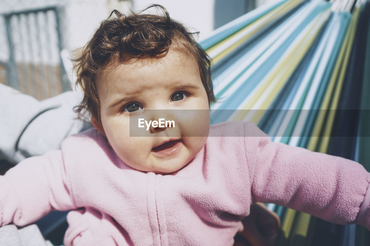 Portrait of cute baby girl at outdoors