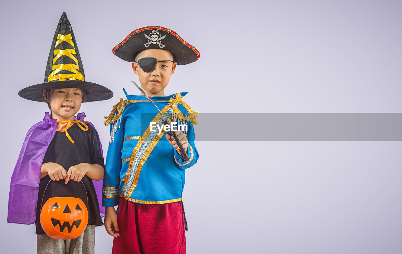 childhood, boys, costume, men, clothing, child, standing, hat, males, front view, two people, halloween, celebration, looking at camera, dressing up, copy space, three quarter length, people, innocence