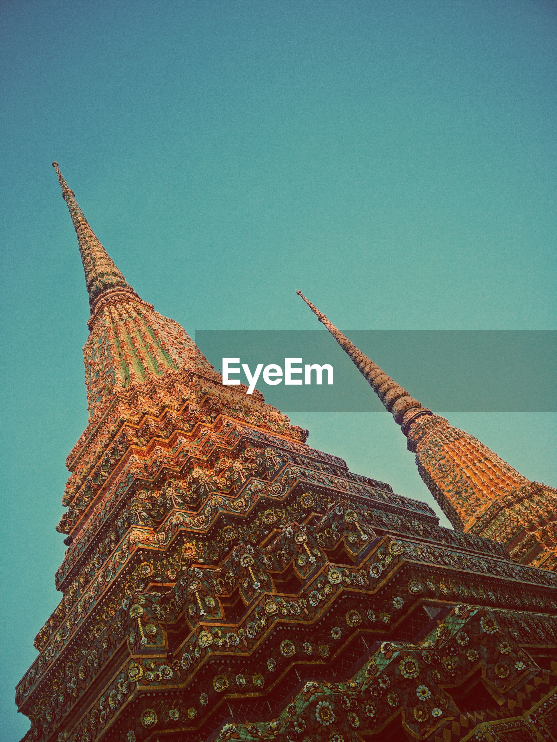 Low angle view of wat pho against clear sky