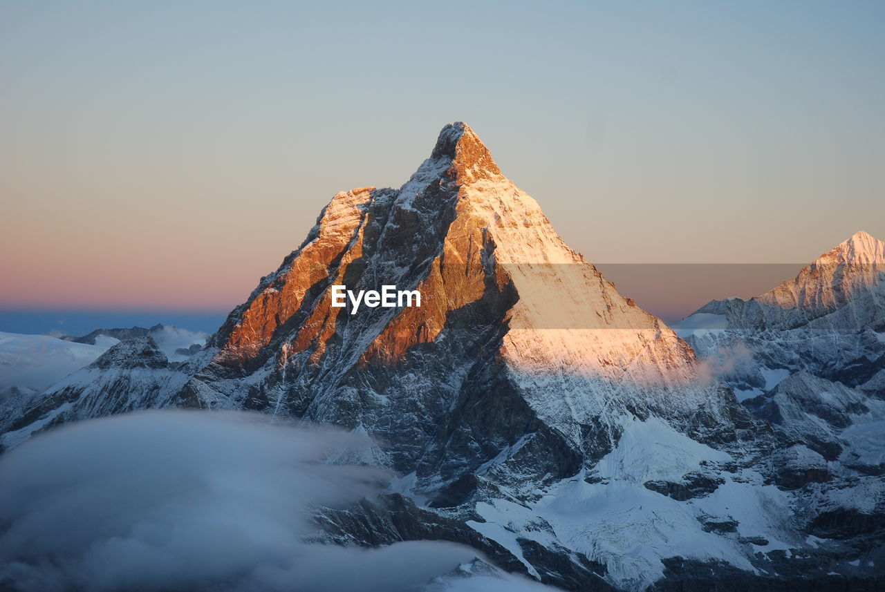 Mountain Peak Against Clear Sky