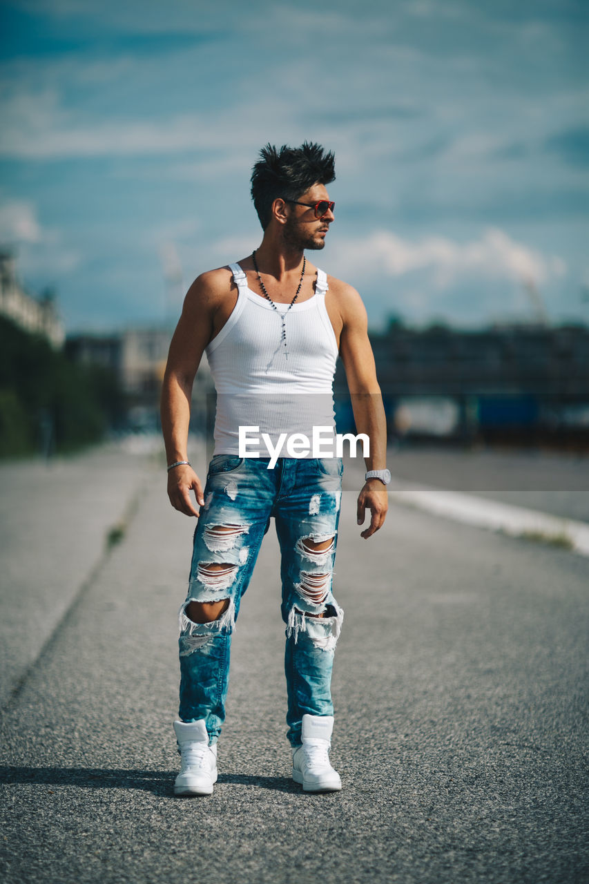 Handsome man standing on road