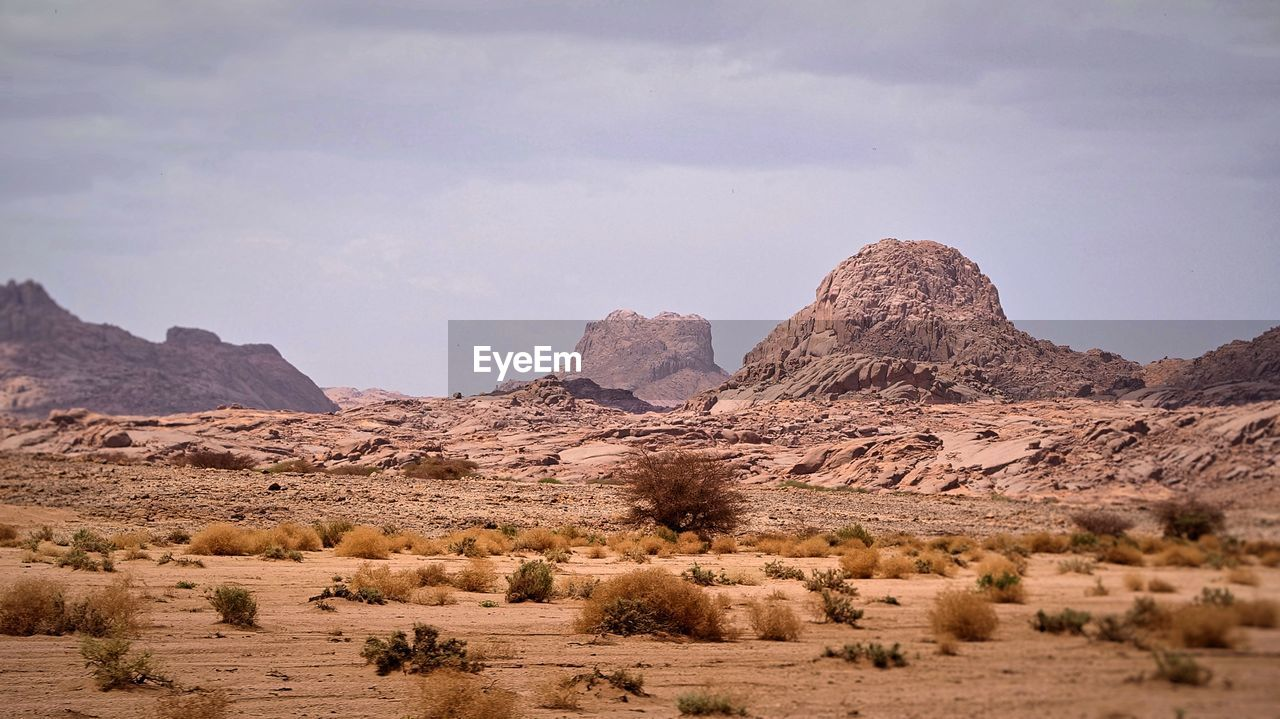 sky, scenics - nature, tranquil scene, landscape, beauty in nature, environment, mountain, tranquility, rock, cloud - sky, non-urban scene, rock formation, nature, mountain range, desert, physical geography, rock - object, day, land, no people, arid climate, climate, formation, semi-arid