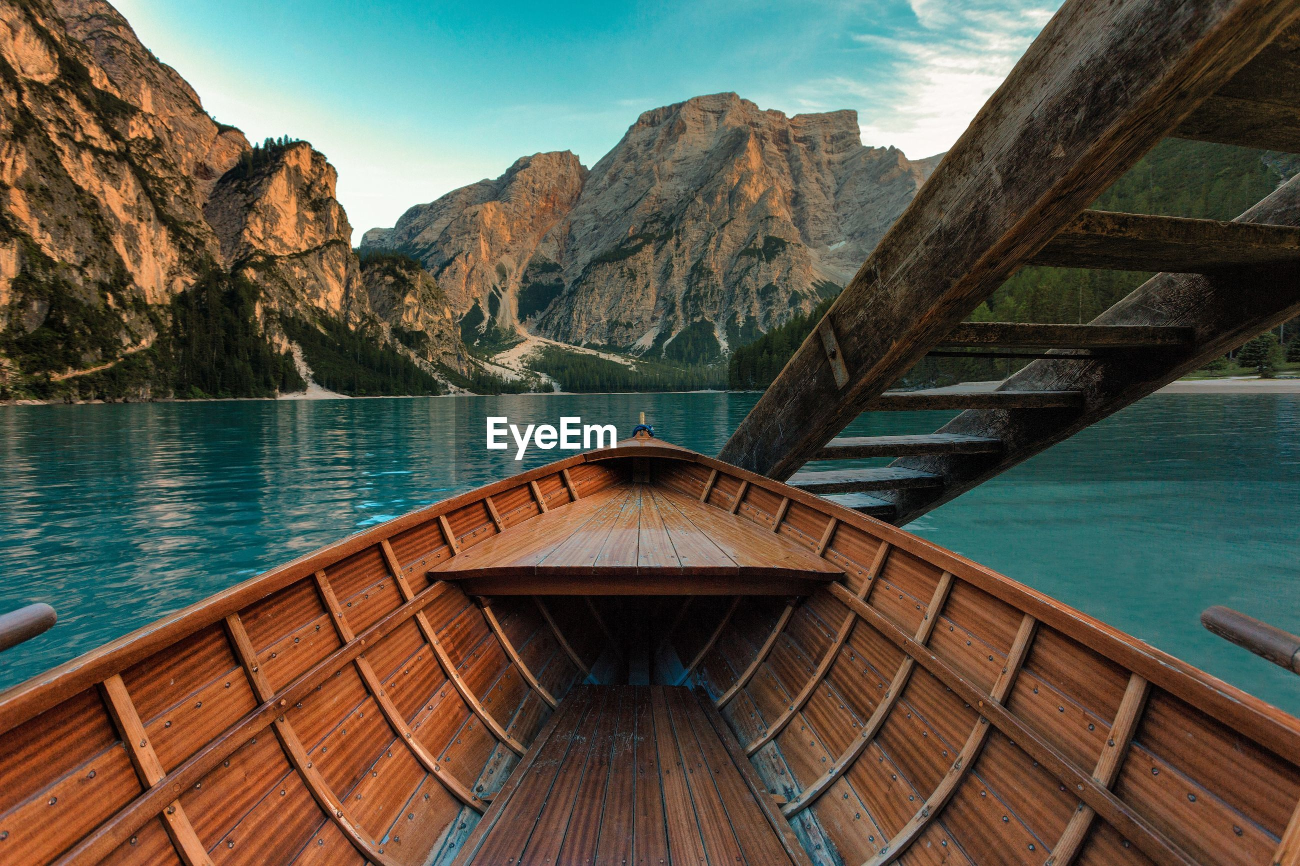 Boat in lake against mountains