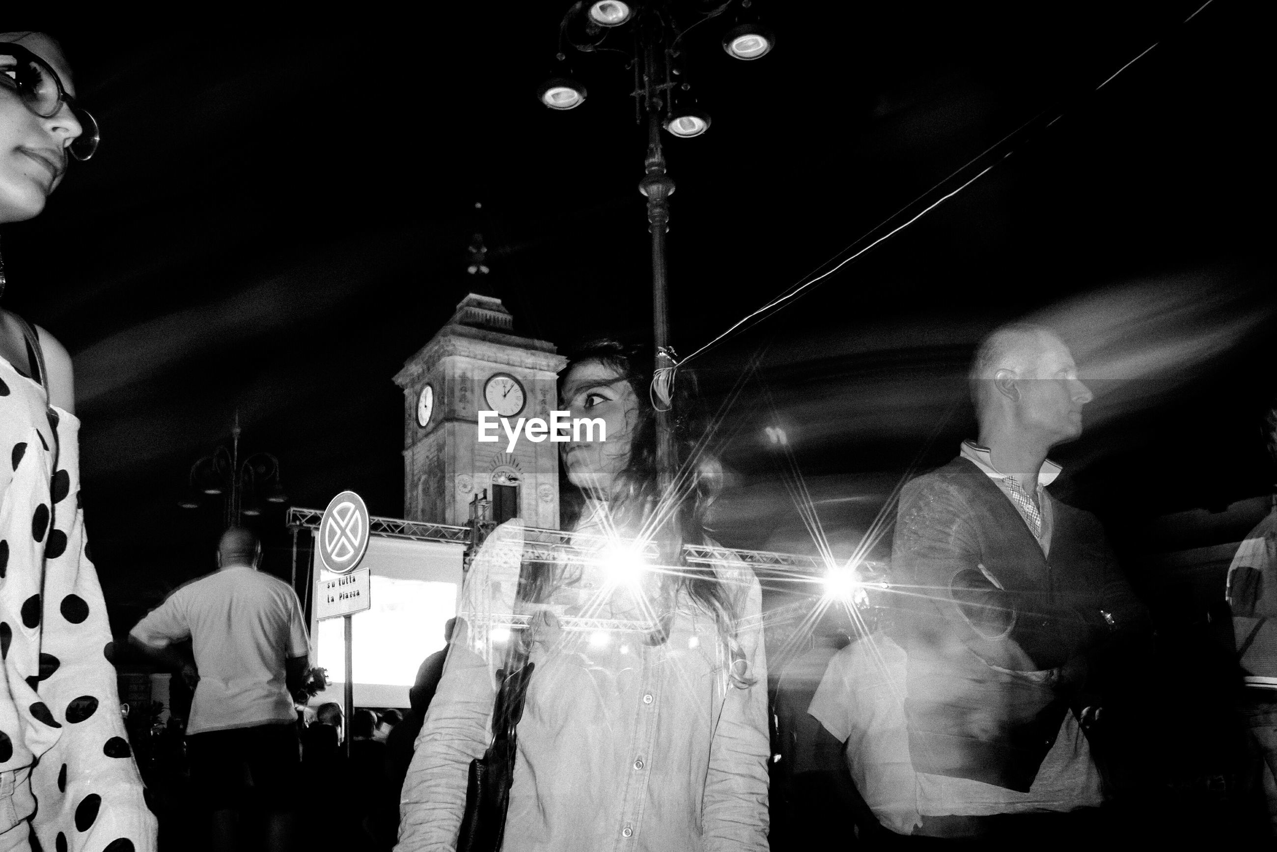 PEOPLE AT ILLUMINATED CATHEDRAL