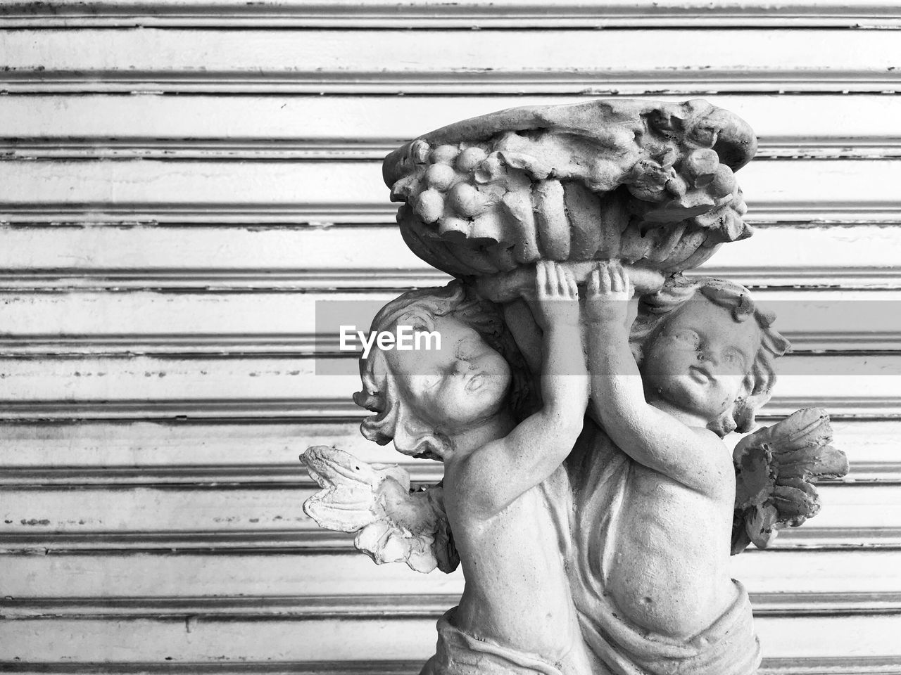sculpture, representation, statue, art and craft, human representation, architecture, creativity, day, male likeness, no people, built structure, holding, close-up, craft, the past, history, outdoors, female likeness