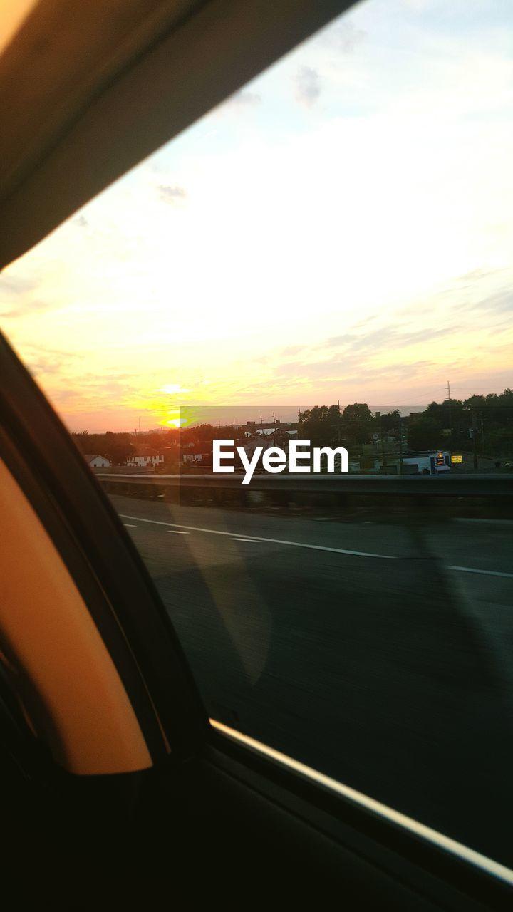 sunset, car, transportation, vehicle interior, sky, road, car interior, mode of transport, window, no people, land vehicle, cloud - sky, nature, sunlight, sun, scenics, tree, outdoors, close-up, day