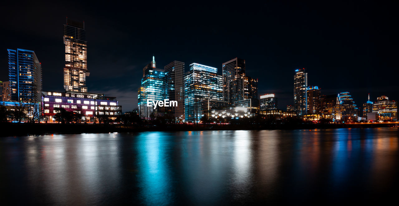 building exterior, architecture, built structure, night, city, illuminated, water, waterfront, office building exterior, reflection, building, sky, landscape, urban skyline, tall - high, river, skyscraper, modern, no people, cityscape, nightlife, financial district