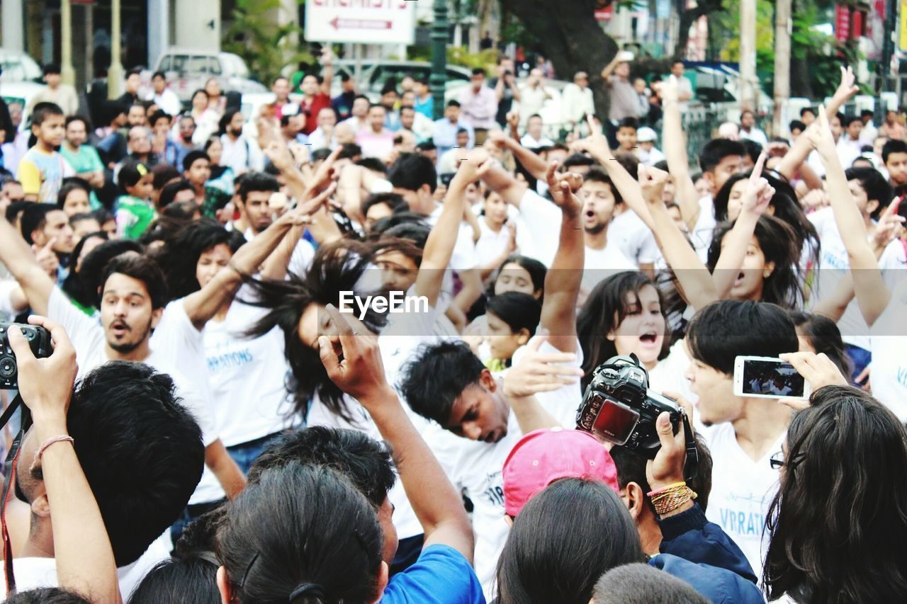 Crowd dancing on street during carnival