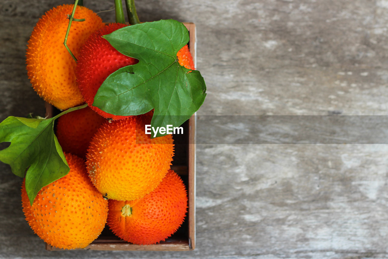 plant part, leaf, food, fruit, citrus fruit, food and drink, freshness, orange color, no people, healthy eating, green color, orange, wellbeing, close-up, orange - fruit, nature, plant, day, outdoors, focus on foreground, ripe
