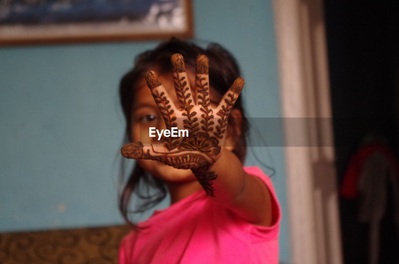 Young Girl Showing Henna Painted On Hand