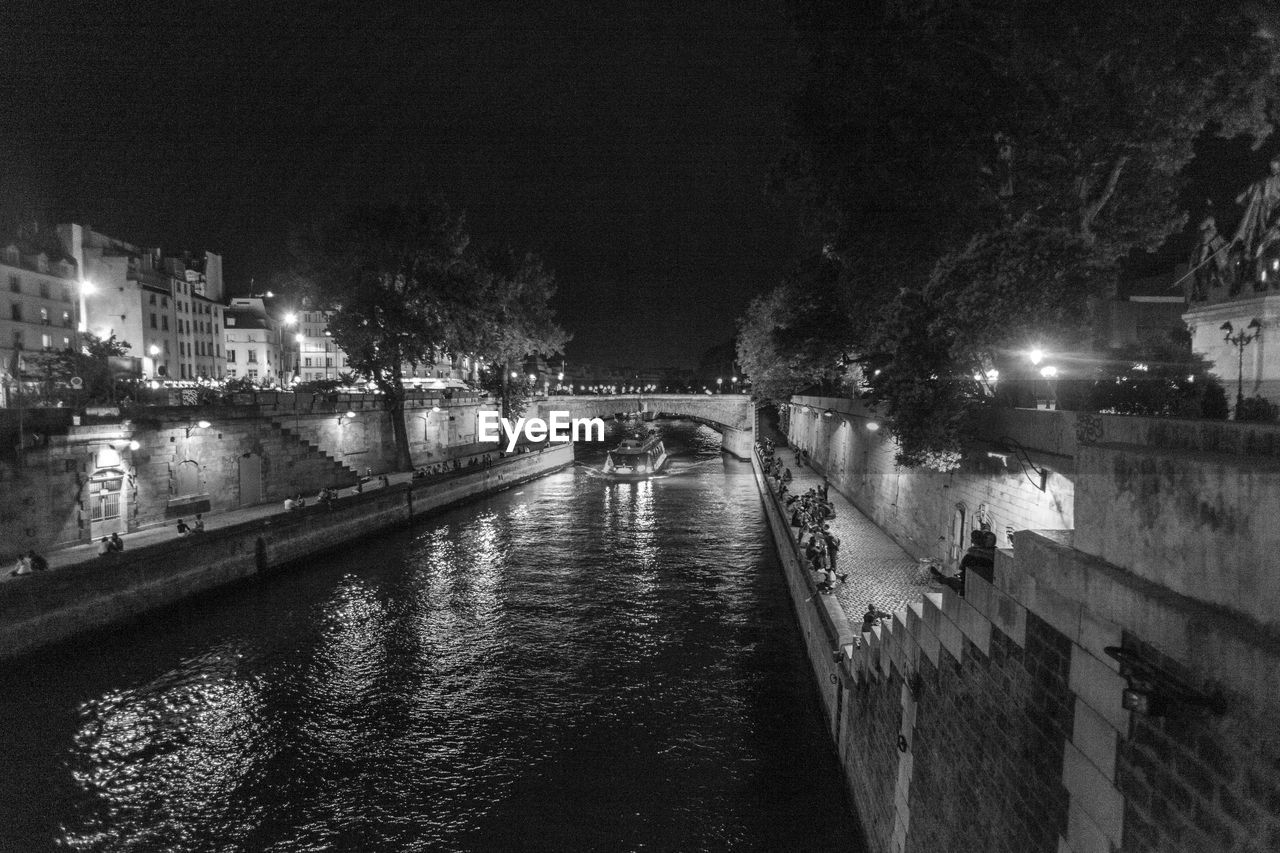 architecture, built structure, night, water, illuminated, building exterior, city, bridge, canal, connection, nature, bridge - man made structure, reflection, transportation, incidental people, tree, outdoors, waterfront