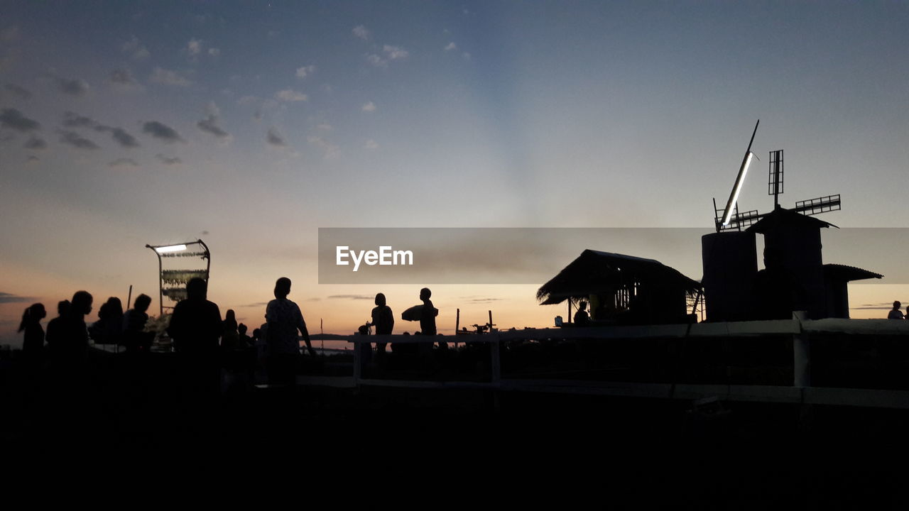 silhouette, sky, sunset, cloud - sky, outdoors, large group of people, real people, built structure, men, leisure activity, nature, architecture, beauty in nature, day, windmill, people