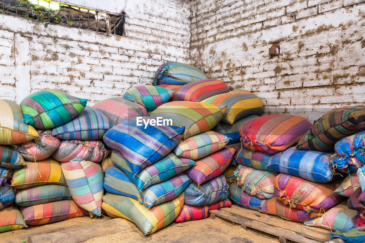 Multi Colored Sacks By Wall