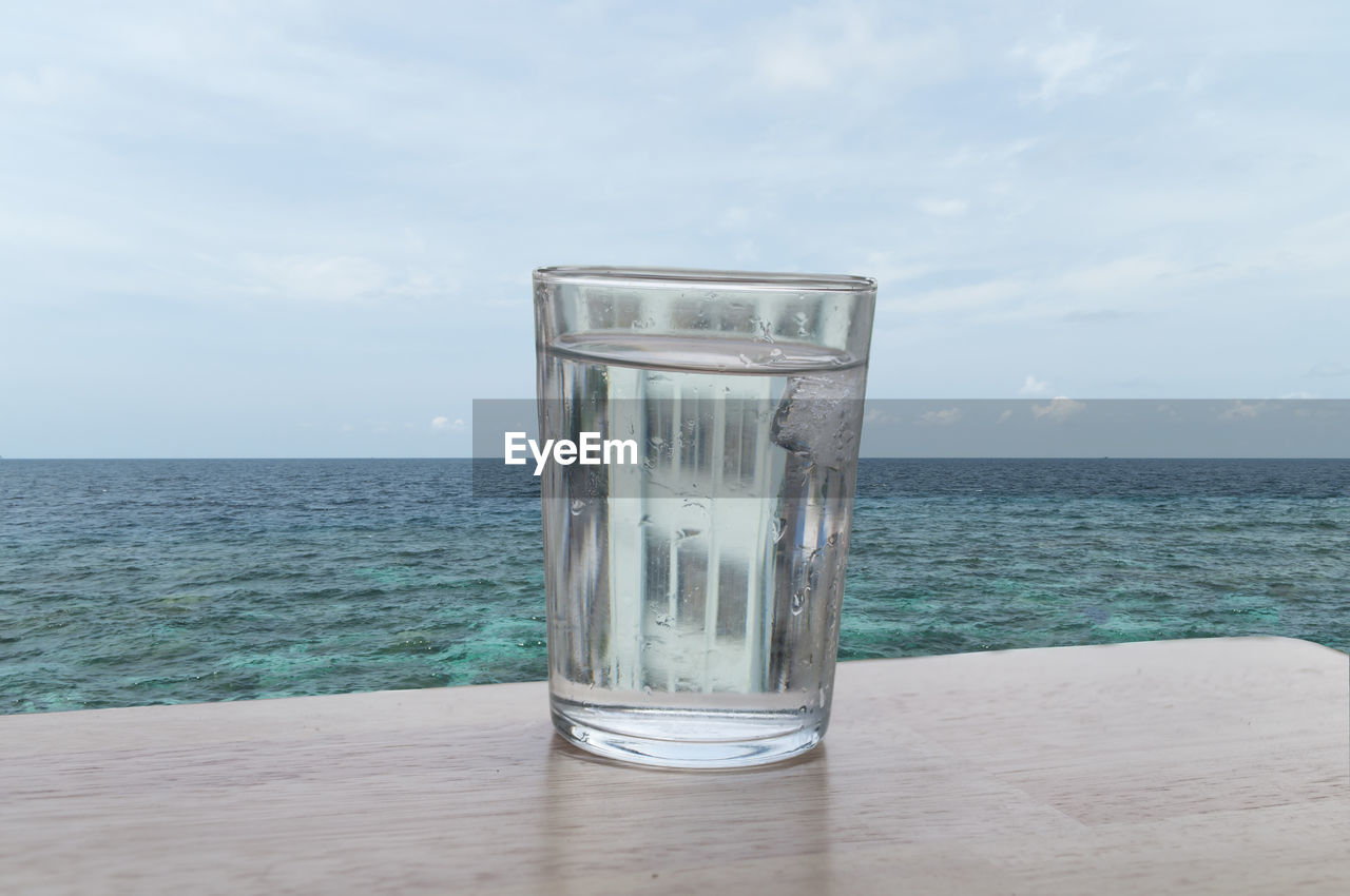 sea, horizon over water, water, sky, nature, beauty in nature, day, no people, drinking glass, scenics, cloud - sky, drink, beach, outdoors, close-up