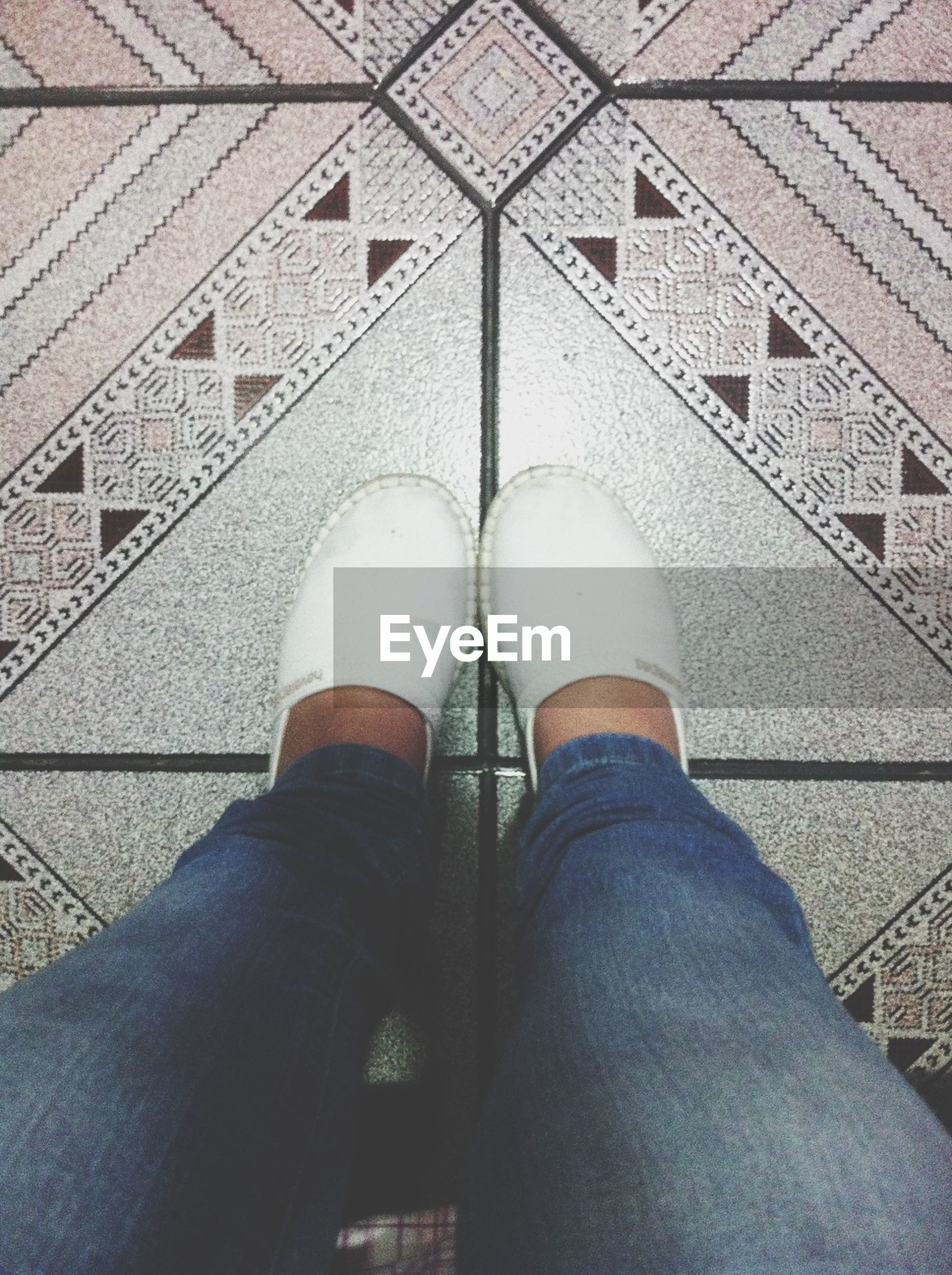 low section, person, personal perspective, shoe, standing, lifestyles, human foot, jeans, men, high angle view, footwear, unrecognizable person, leisure activity, tiled floor, indoors, part of