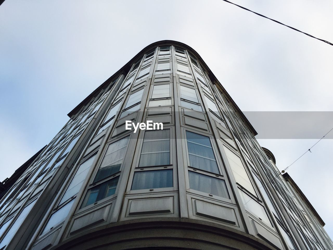 low angle view, architecture, building exterior, built structure, day, outdoors, skyscraper, no people, modern, sky, corporate business, city