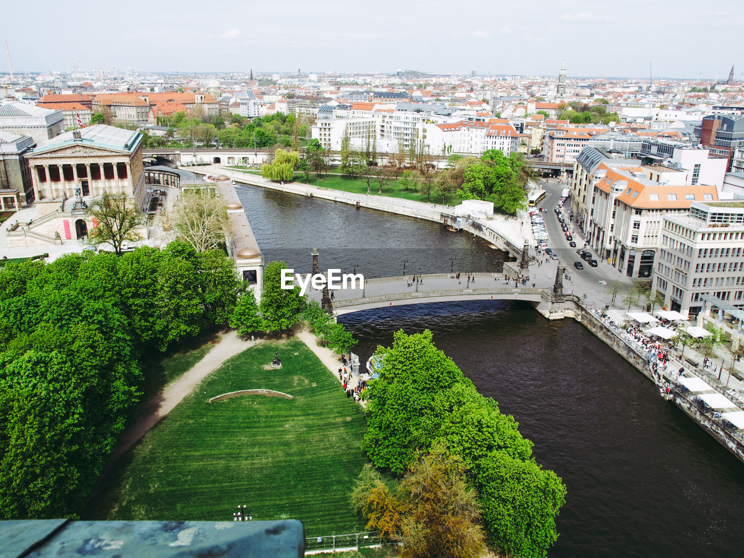 HIGH ANGLE VIEW OF ARCH BRIDGE OVER RIVER AND CITYSCAPE