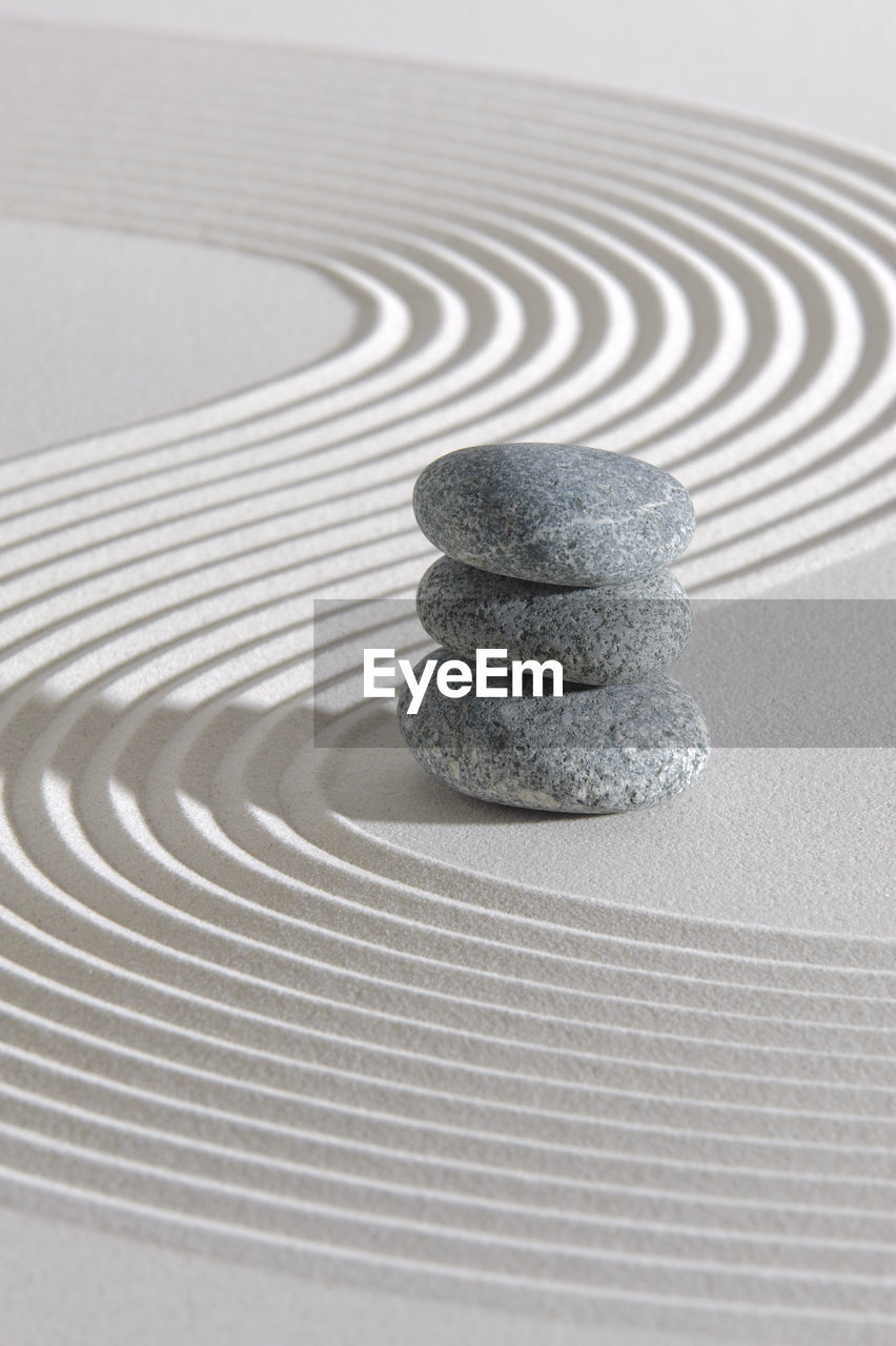 balance, stack, pebble, stone, no people, zen-like, rock, solid, indoors, stone - object, pattern, close-up, shape, focus on foreground, rock - object, studio shot, still life, nature, design, circle, concentric, purity