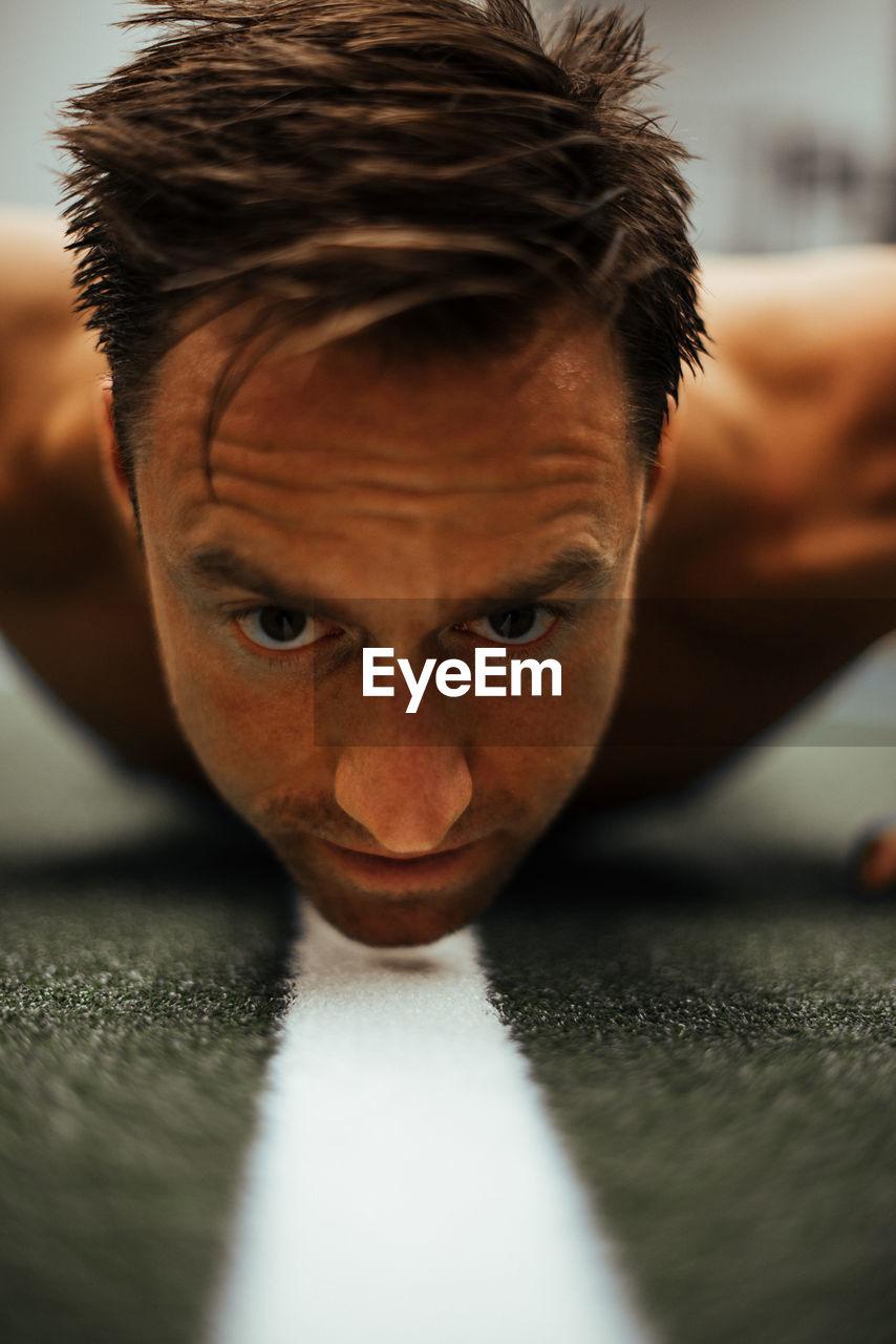 Shirtless Man Exercising In Gym