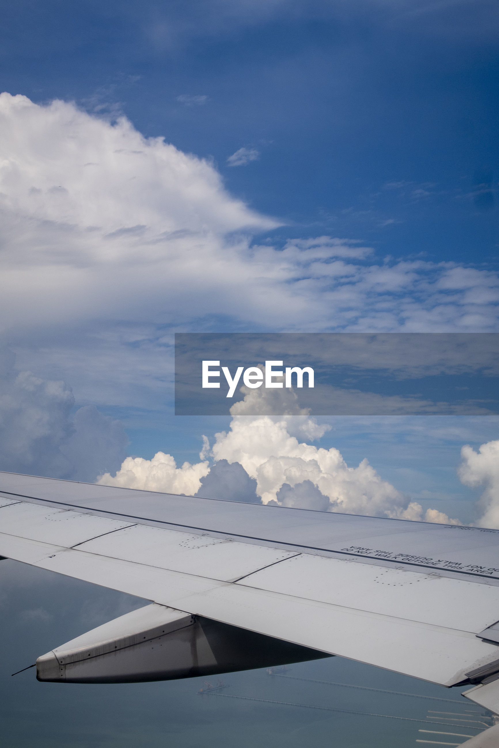 cloud - sky, air vehicle, airplane, sky, aircraft wing, mode of transportation, transportation, day, no people, nature, scenics - nature, travel, flying, beauty in nature, outdoors, public transportation, blue, motion, airport, sunlight