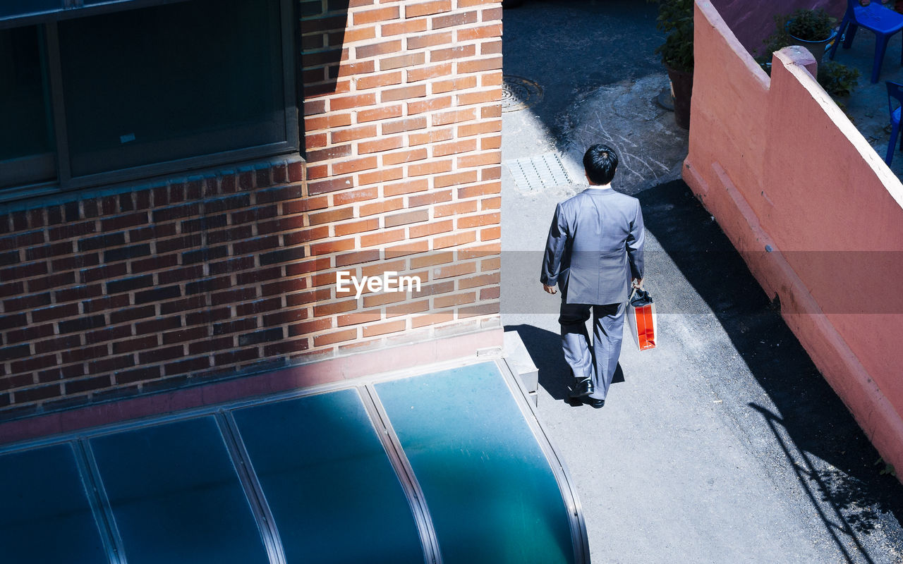 High Angle View Of Businessman Walking On Street