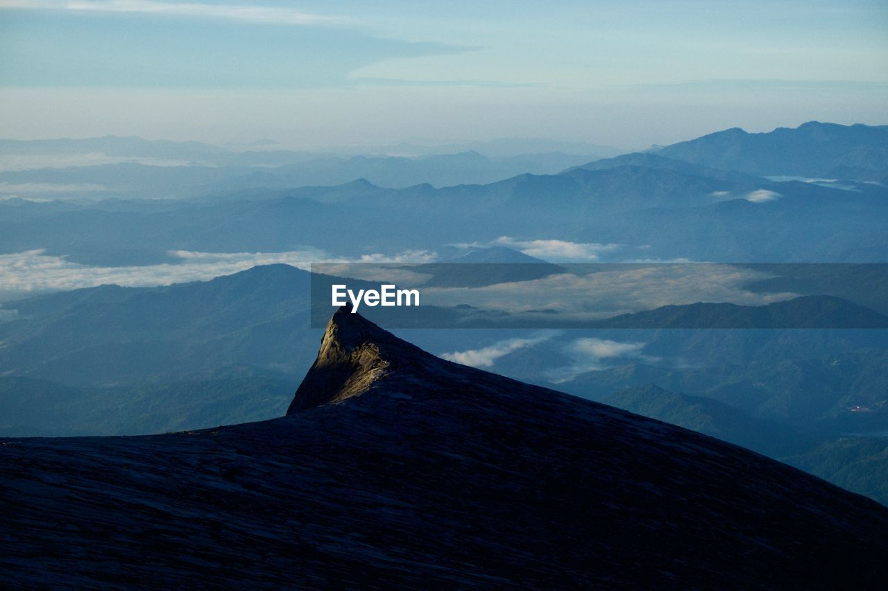 mountain, scenics - nature, beauty in nature, sky, tranquil scene, tranquility, mountain range, non-urban scene, nature, no people, idyllic, cloud - sky, landscape, environment, day, mountain peak, remote, outdoors, volcano, tourism, volcanic crater, mountain ridge