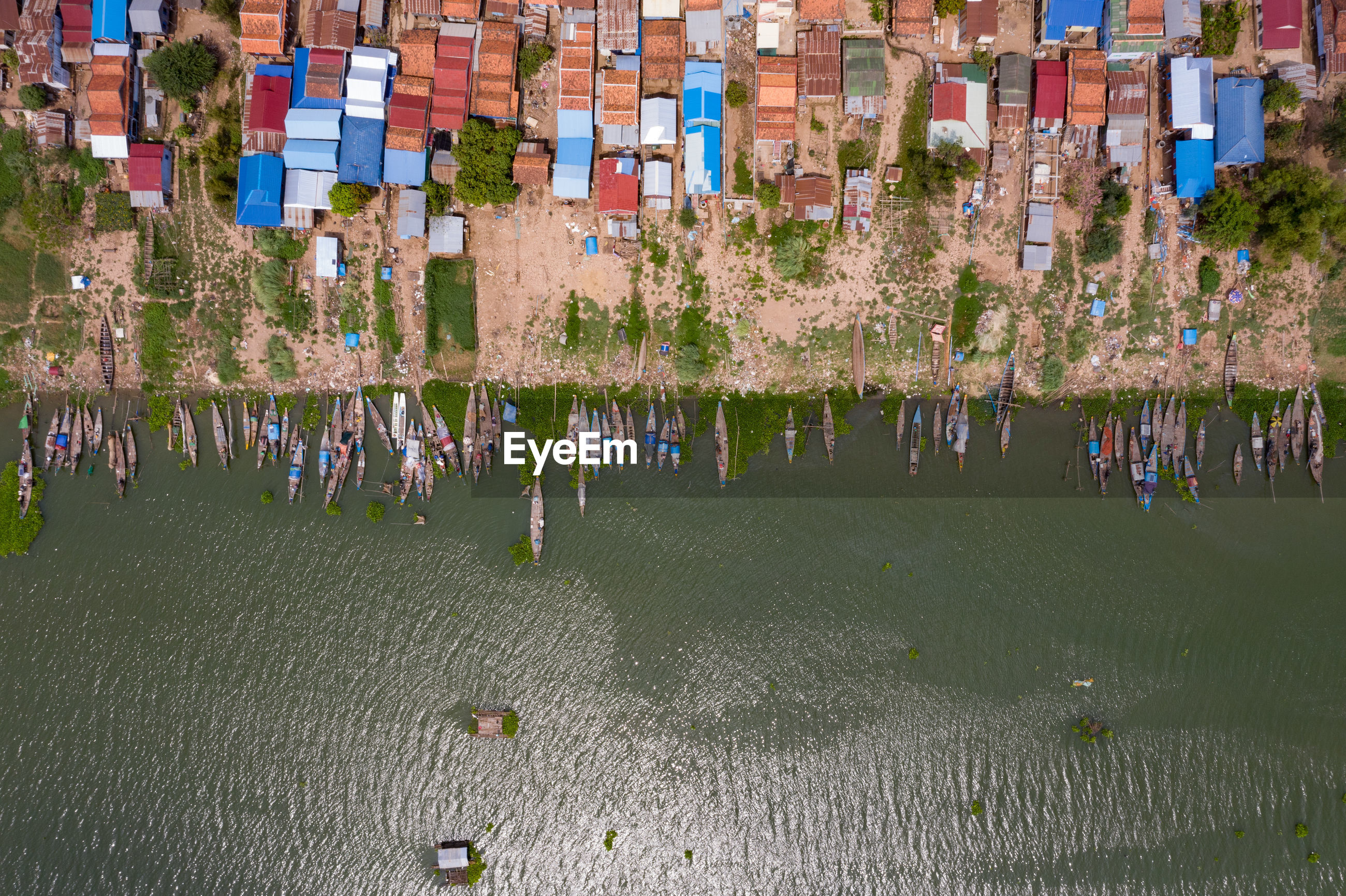 Aerial view of houses by sea in town