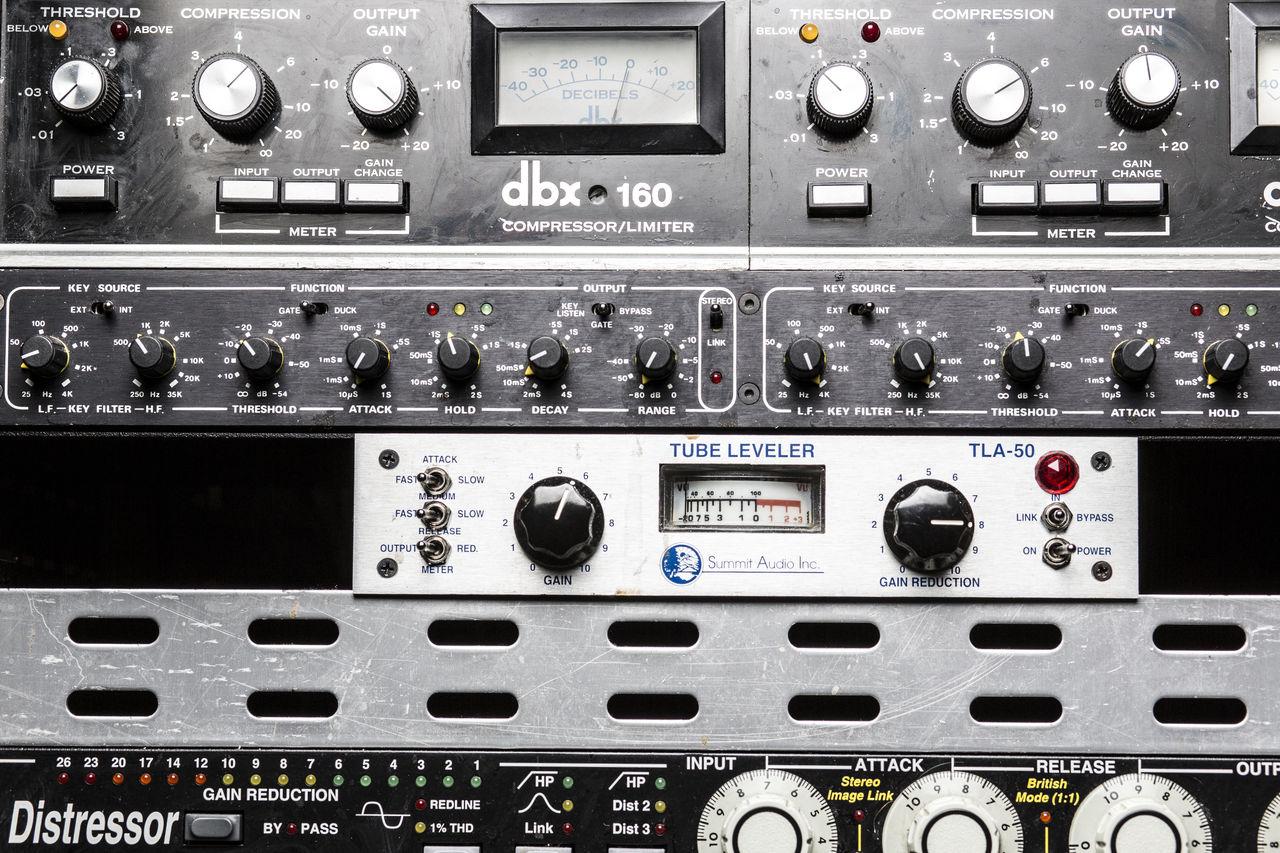 Close-Up Of Sound Mixer Control Panel In Studio