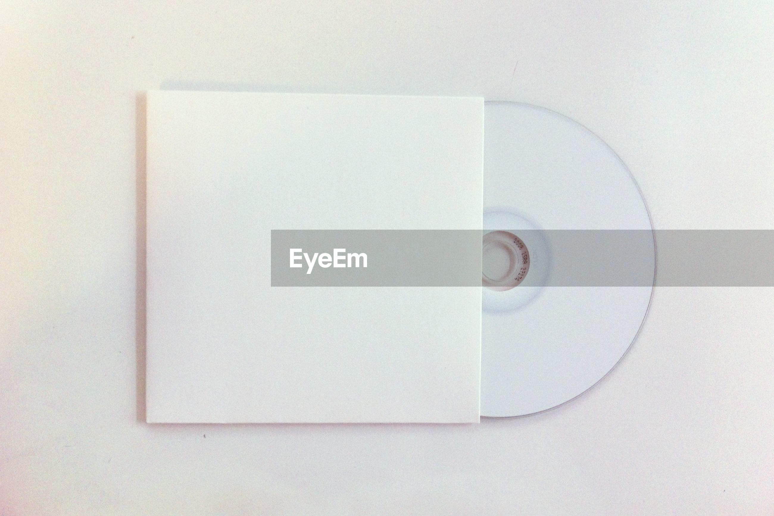 High angle view of disc on white background