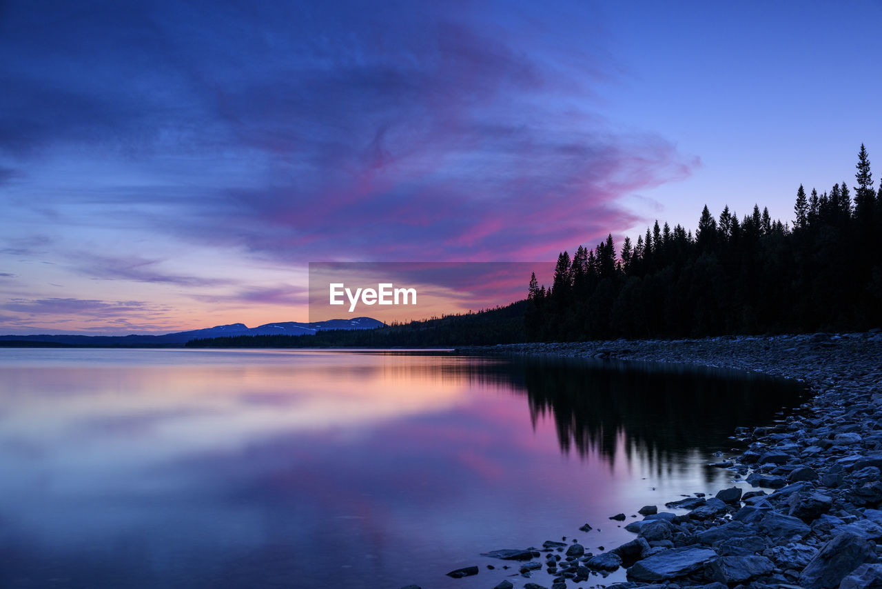 sky, scenics - nature, water, beauty in nature, tranquility, tranquil scene, sunset, cloud - sky, lake, reflection, idyllic, nature, non-urban scene, tree, no people, plant, orange color, remote, waterfront, outdoors, purple