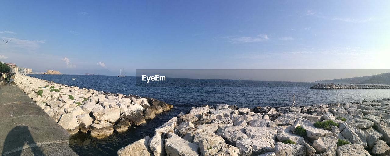 water, rock, sky, sea, solid, scenics - nature, rock - object, beauty in nature, tranquil scene, tranquility, nature, day, sunlight, no people, land, cloud - sky, horizon, beach, non-urban scene, outdoors, horizon over water, groyne, rocky coastline