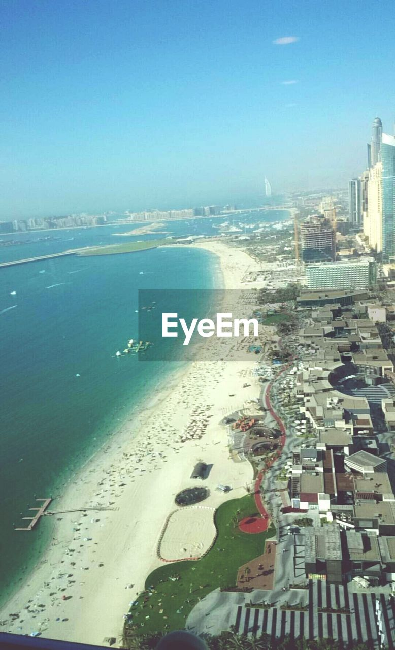 sea, cityscape, city, architecture, building exterior, water, built structure, beach, horizon over water, outdoors, no people, day, sky, scenics, nature, skyscraper, travel destinations, beauty in nature, clear sky