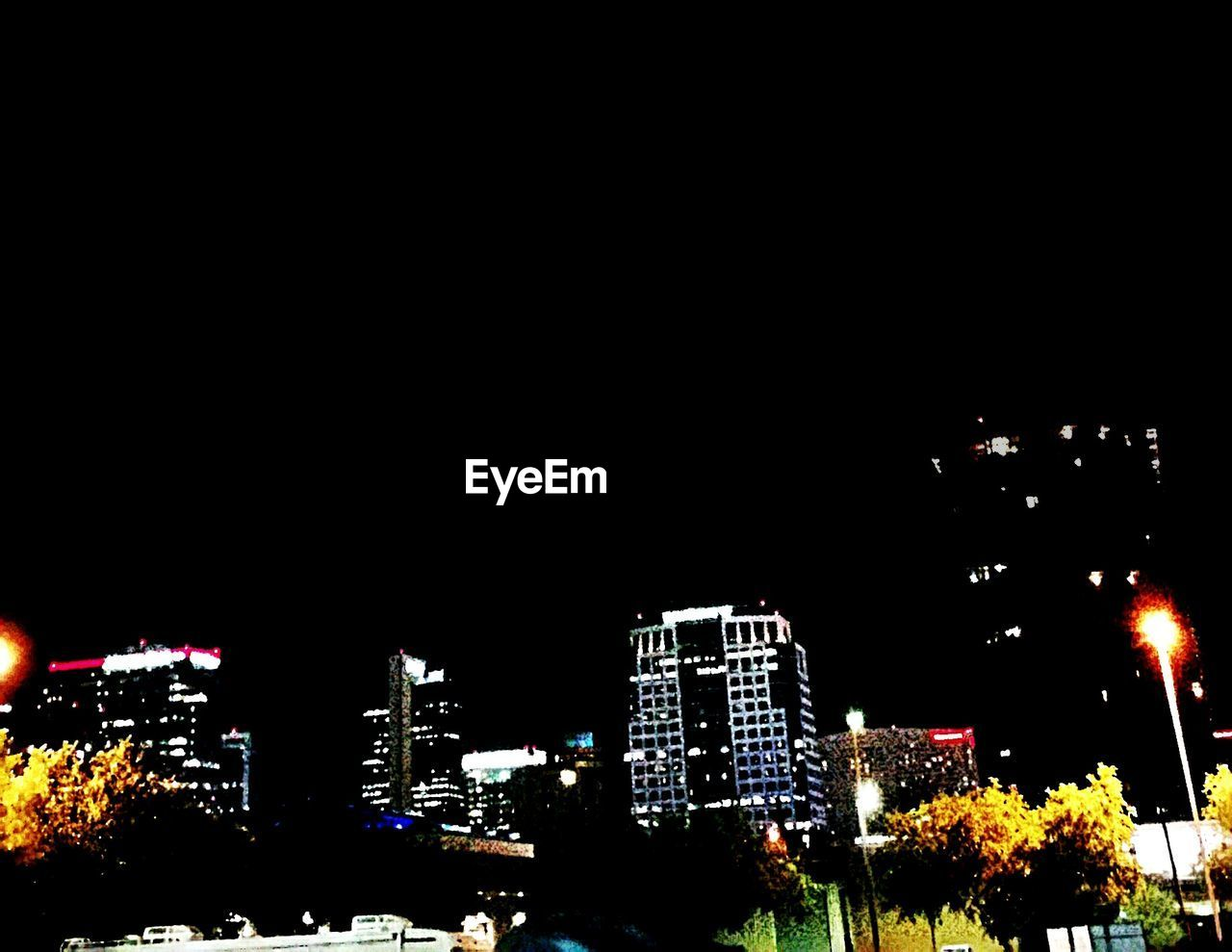 night, illuminated, building exterior, copy space, architecture, no people, built structure, skyscraper, low angle view, outdoors, city, tree, clear sky, growth, cityscape, nature, sky