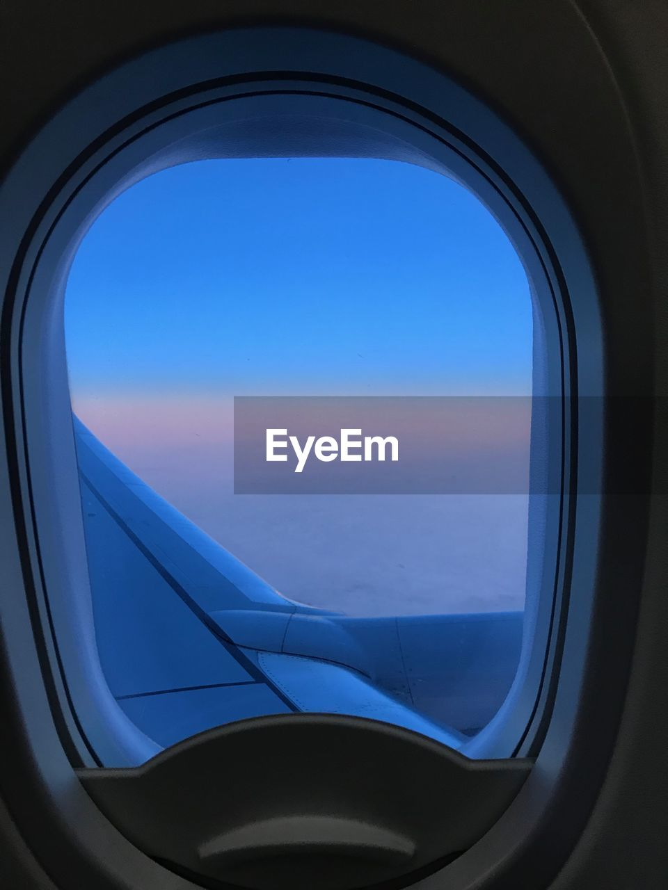 window, sky, glass - material, vehicle interior, transparent, mode of transportation, air vehicle, transportation, airplane, nature, blue, travel, no people, flying, day, mid-air, outdoors, public transportation, cloud - sky