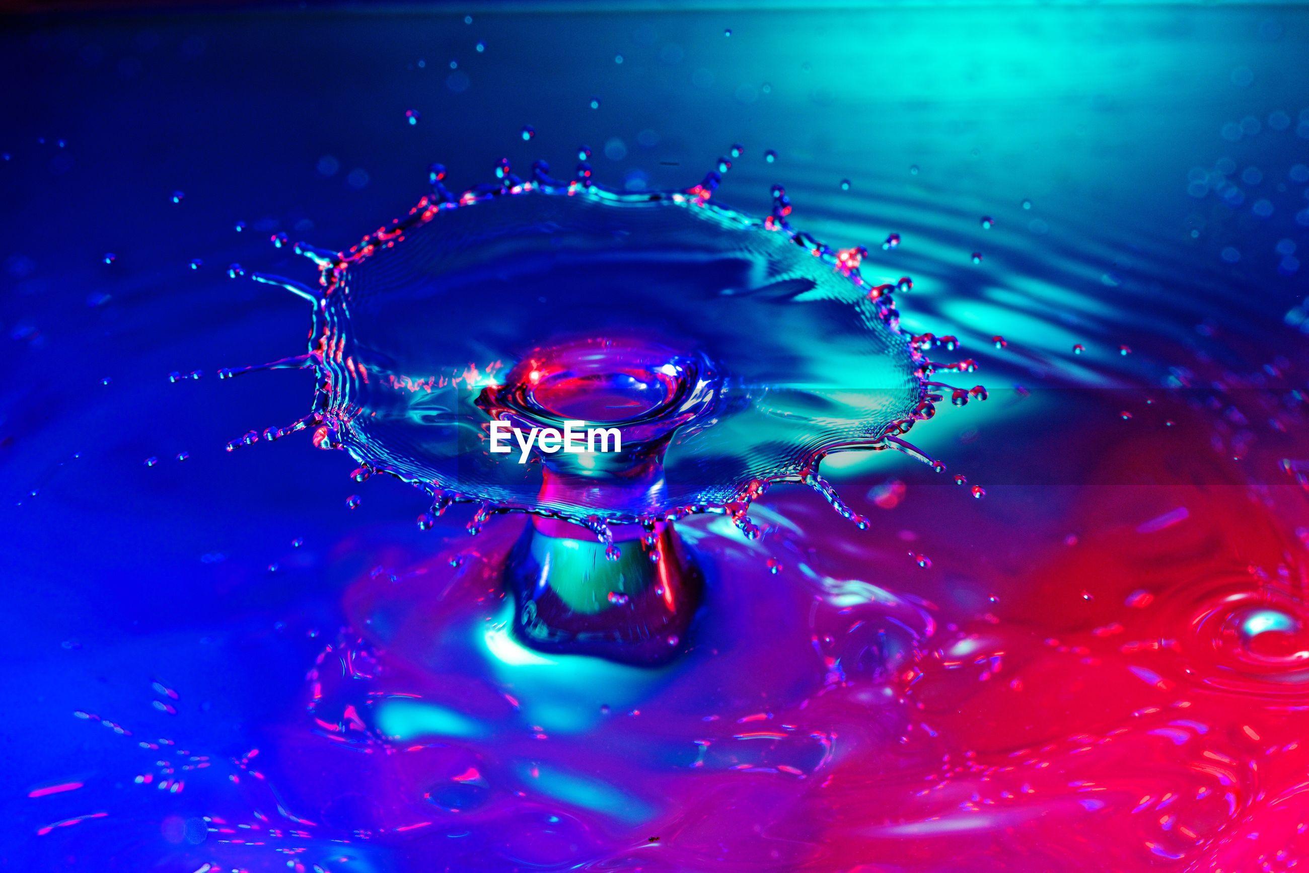 Close-up of water drop splashing