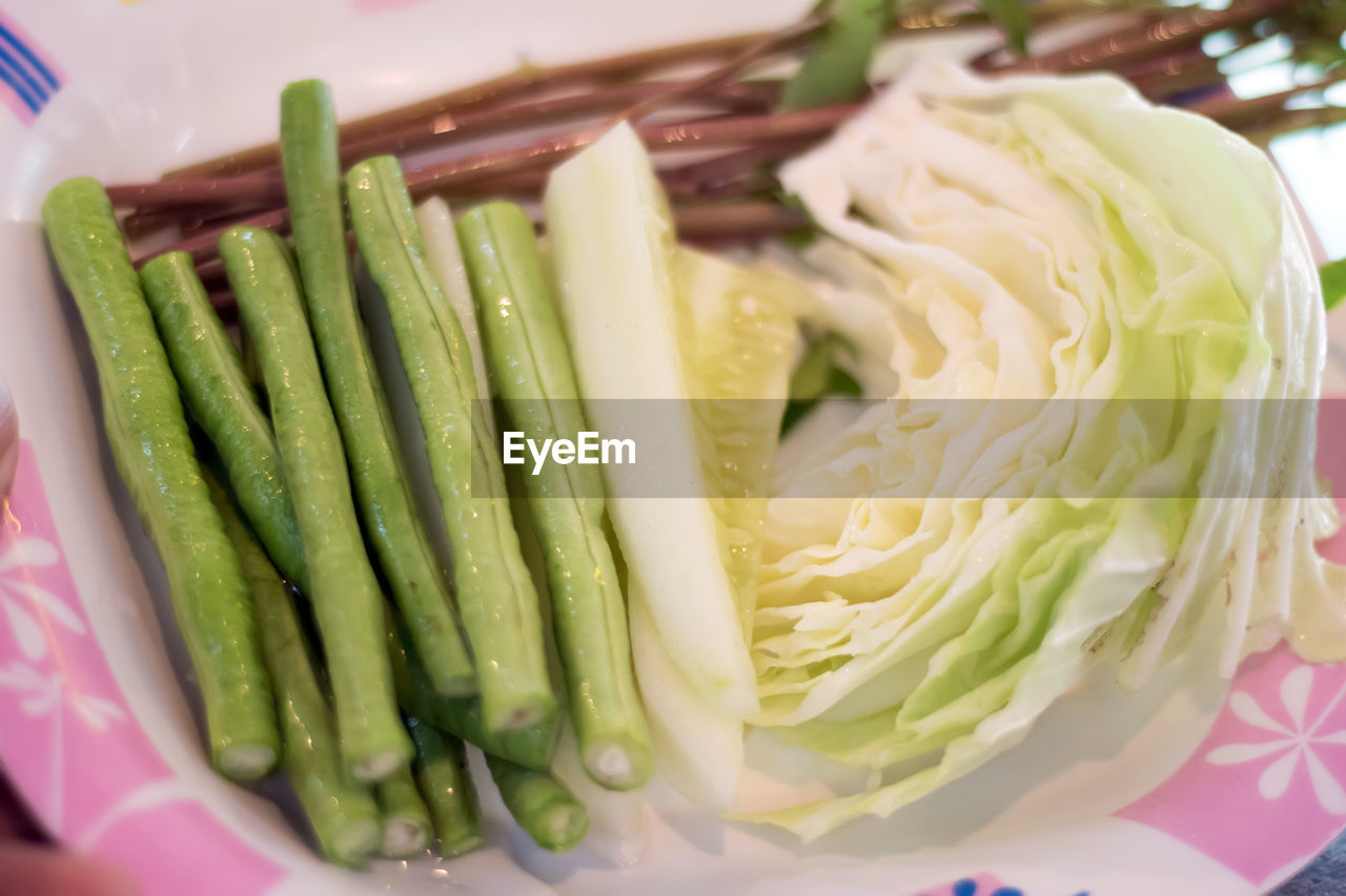 food and drink, food, freshness, healthy eating, vegetable, close-up, no people, still life, ready-to-eat, indoors, wellbeing, green color, plate, serving size, asparagus, high angle view, bowl, focus on foreground, green bean, table, crockery, temptation