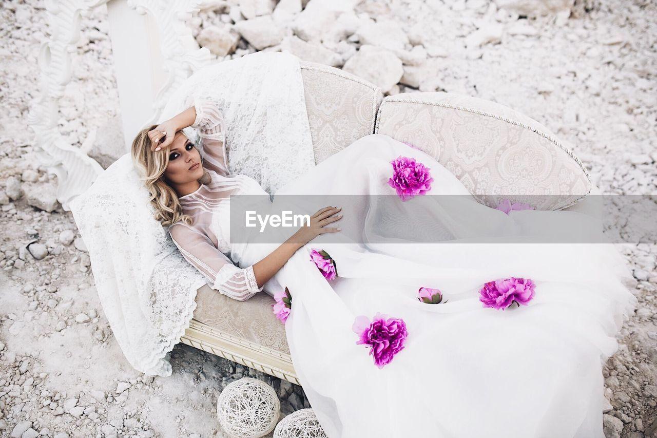High Angle View Of Woman Lying On Sofa