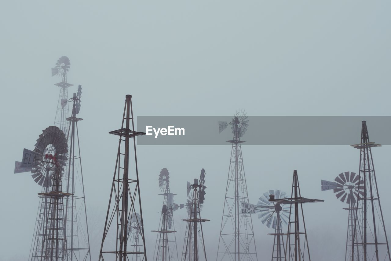 American-style Windmills Against Sky During Foggy Weather