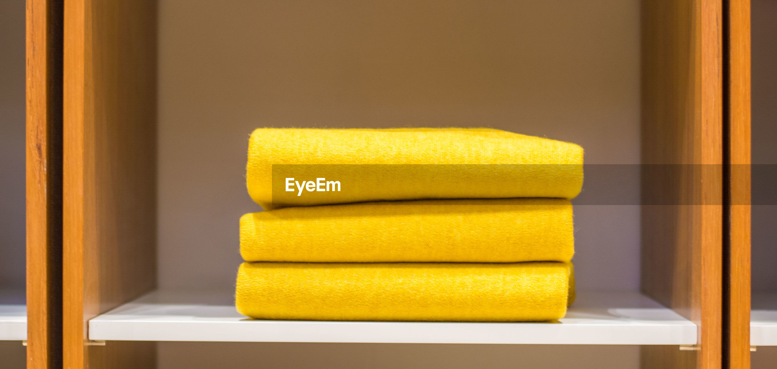 Close-up of yellow towels on table