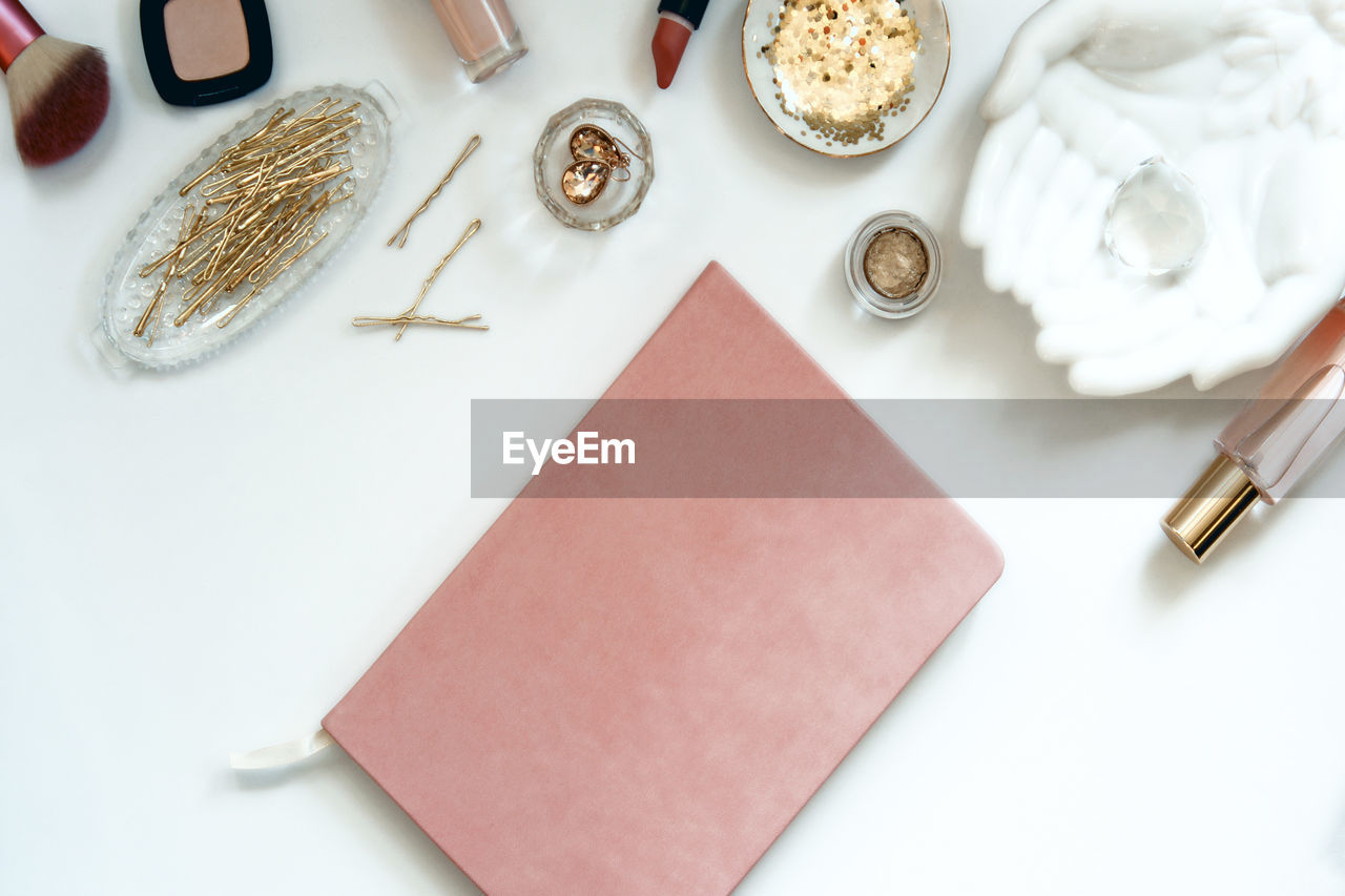 High angle view of personal accessories with diary on table