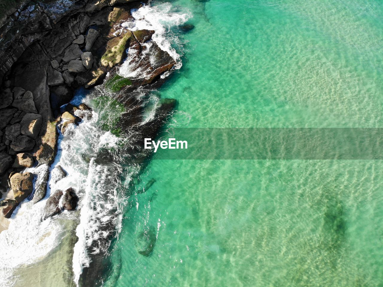 water, sea, rock, rock - object, solid, motion, nature, land, beauty in nature, outdoors, scenics - nature, high angle view, rock formation, no people, day, cliff, beach, sport, wave, turquoise colored, marine, power in nature
