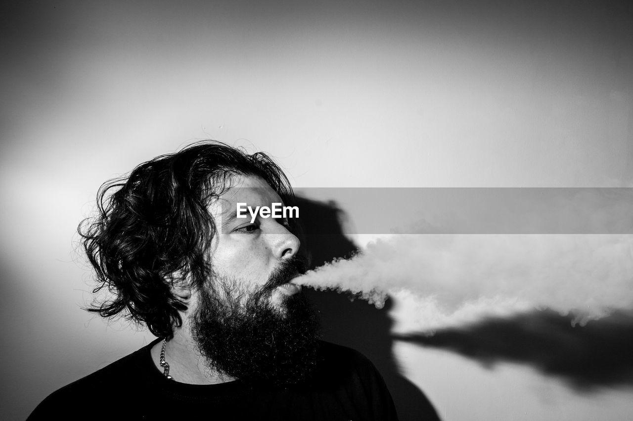 Portrait Of Man Blowing Smoke