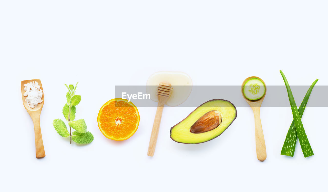 food and drink, food, white background, freshness, studio shot, still life, indoors, healthy eating, wellbeing, no people, green color, copy space, cut out, kitchen utensil, eating utensil, fruit, vegetable, slice, high angle view, spoon
