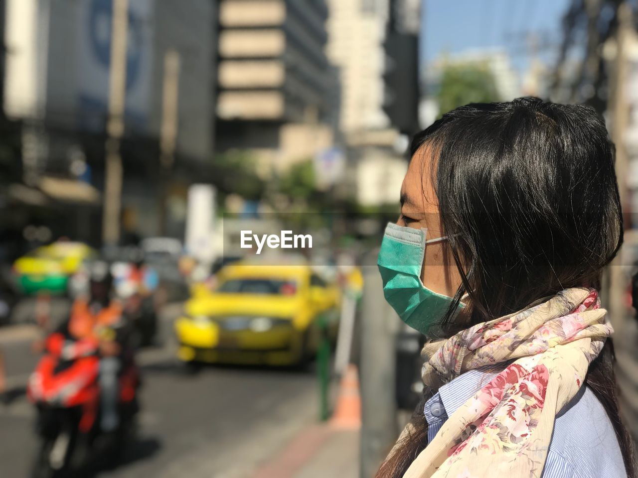Side View Of Woman Protective Mask In City