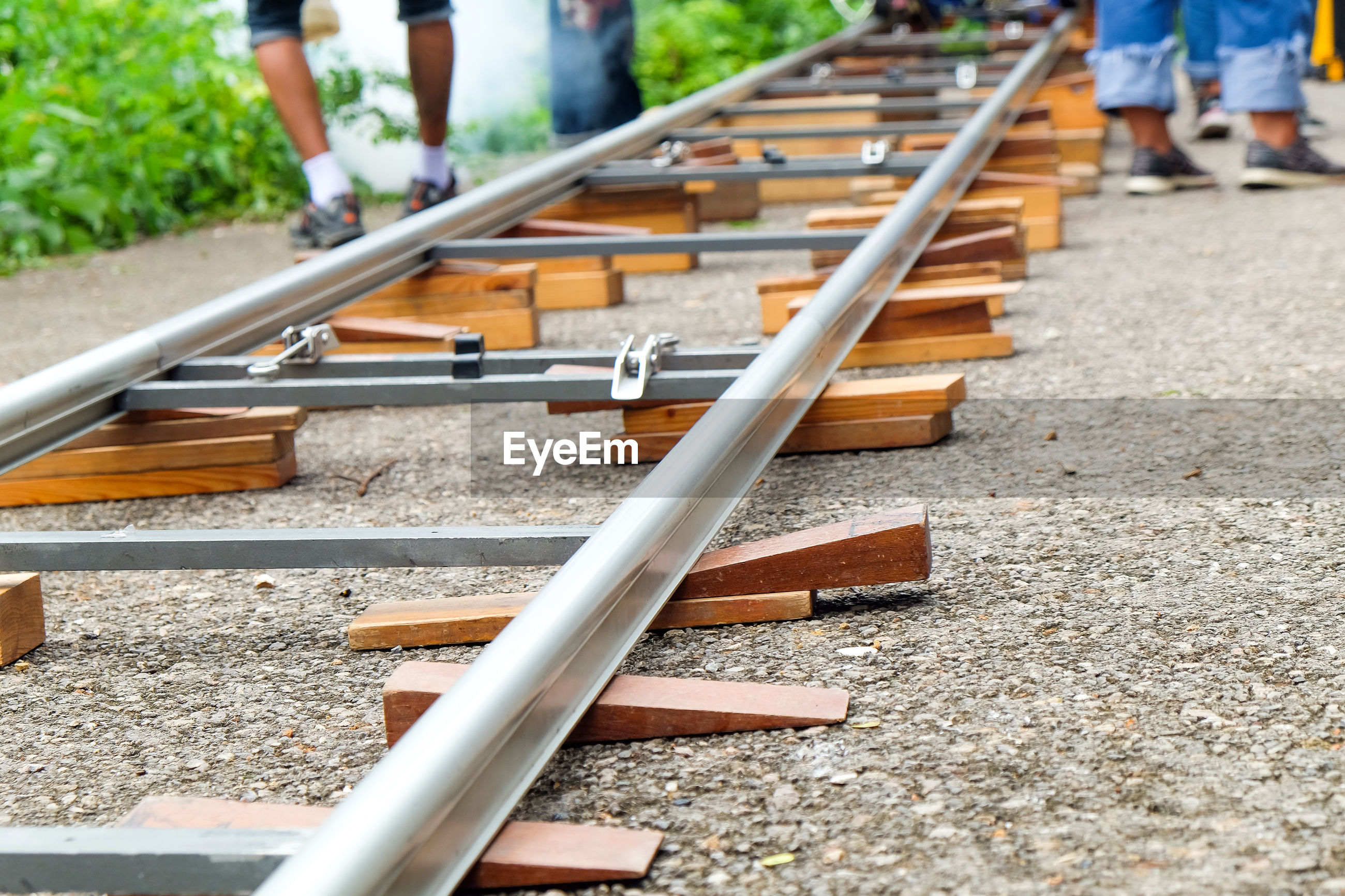 LOW SECTION OF PEOPLE AT RAILROAD TRACKS