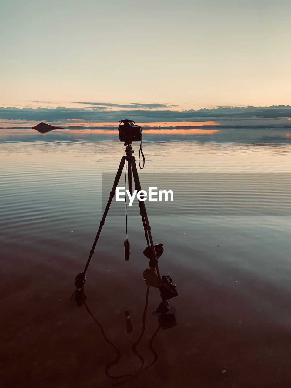 water, sky, sunset, tranquility, scenics - nature, beauty in nature, tranquil scene, reflection, photography themes, tripod, non-urban scene, lake, nature, no people, technology, standing water, camera - photographic equipment, waterfront, silhouette, outdoors, digital camera, salt flat