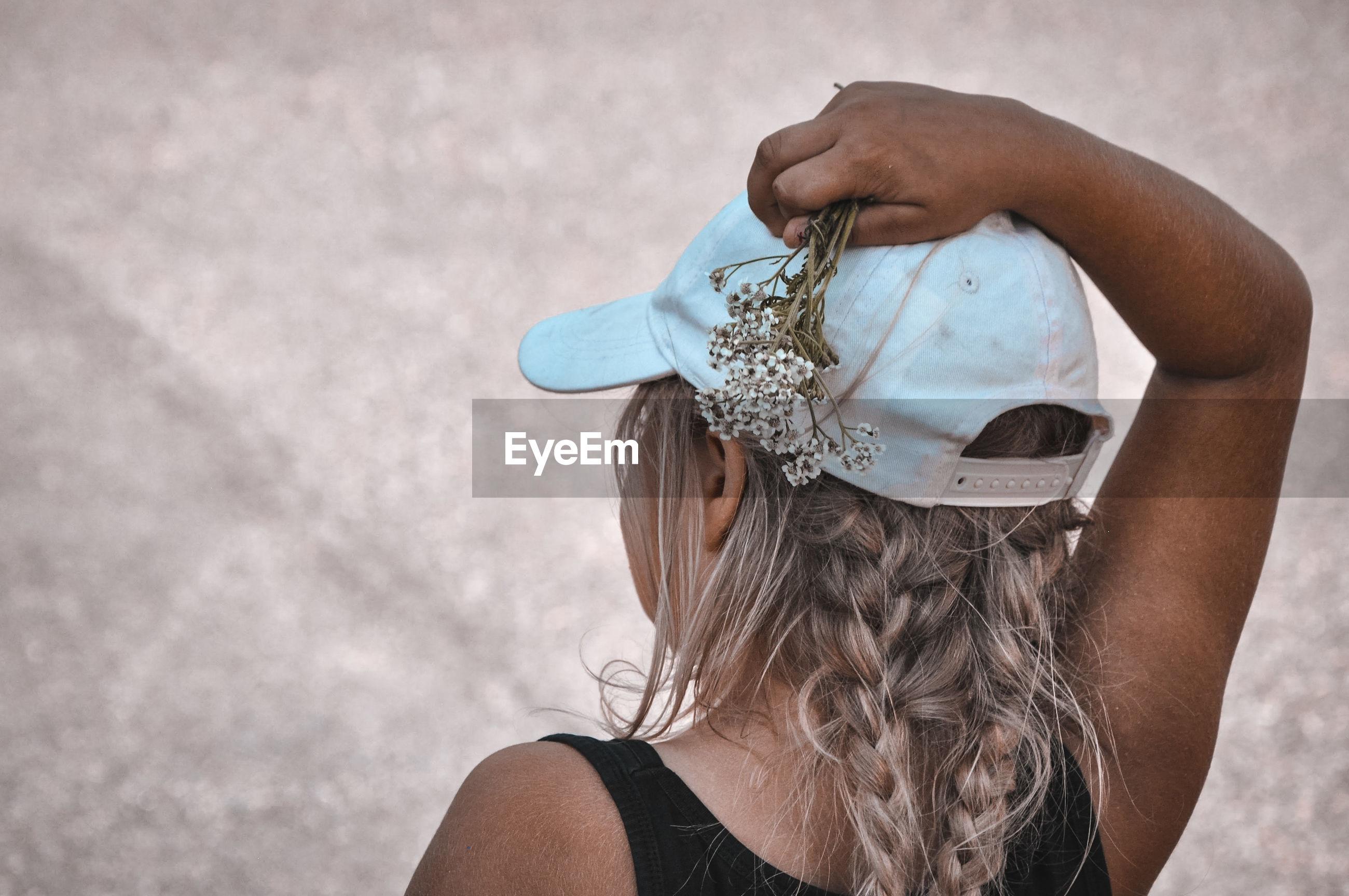 Rear view of girl wearing hat