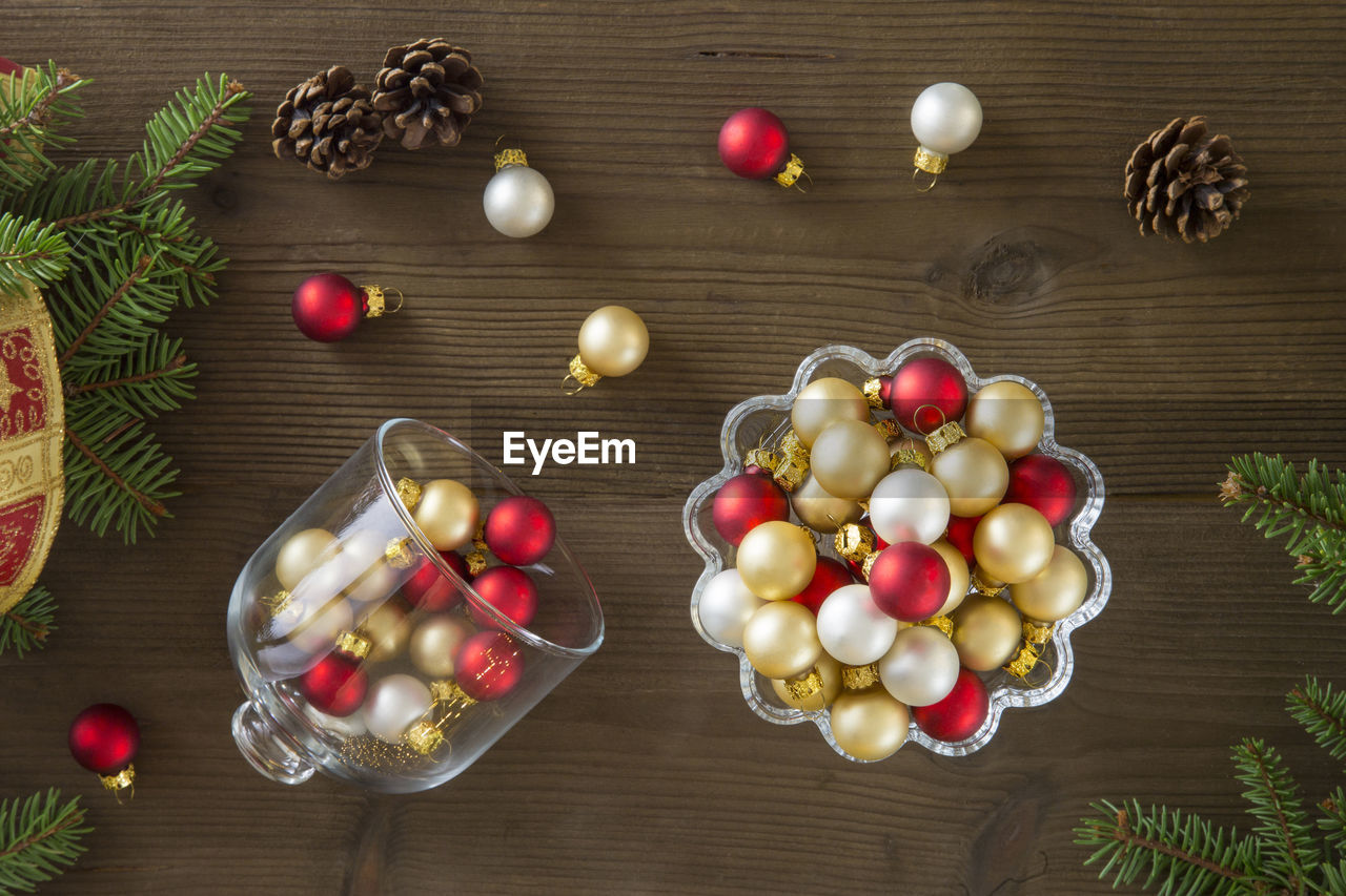Directly above shot of christmas ornaments with pine cones on table