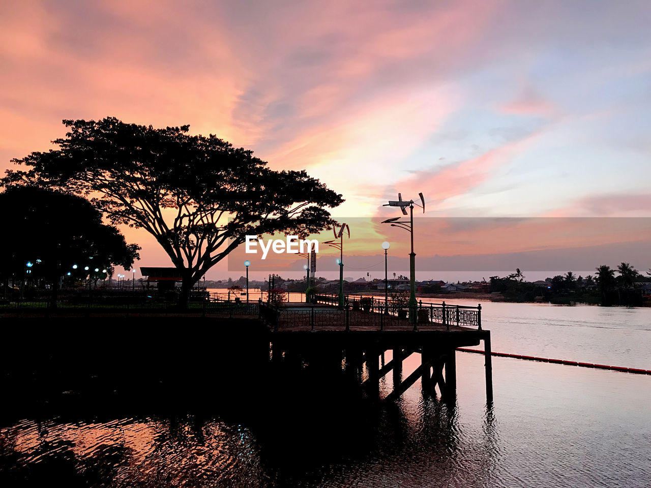 sunset, sky, water, tree, cloud - sky, plant, orange color, nature, architecture, built structure, silhouette, beauty in nature, waterfront, scenics - nature, no people, outdoors, reflection, lake